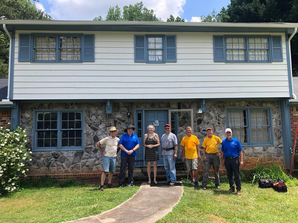 homeowner and HRM standing out front of home after repairs were done