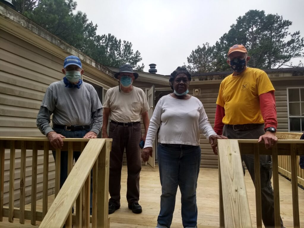 shows volunteers standing on new completed deck